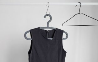 Black shirt hanging on a clothes hanger