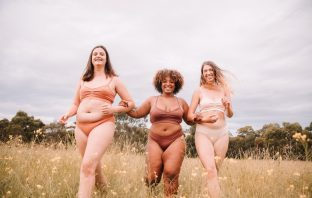 Three models in a field wearing neutral coloured underwear
