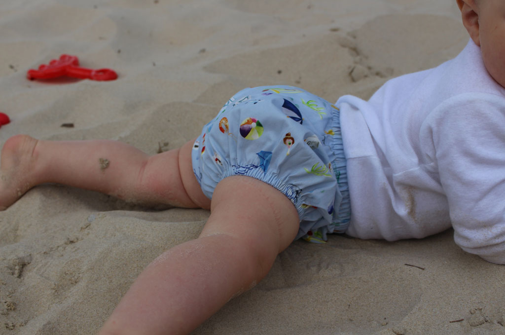Baby lying on the sand